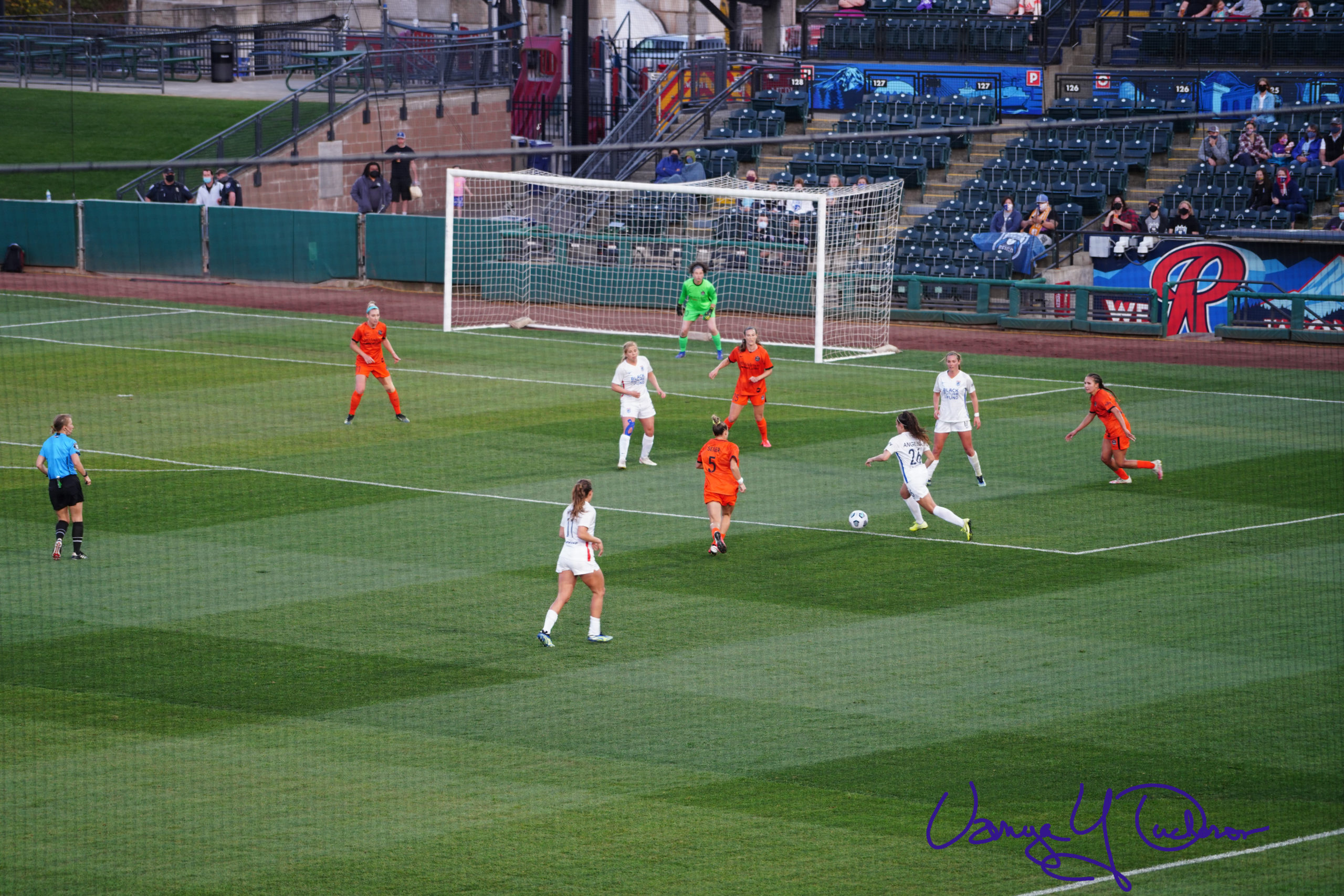 Angelina takes a shot from the edge of the box