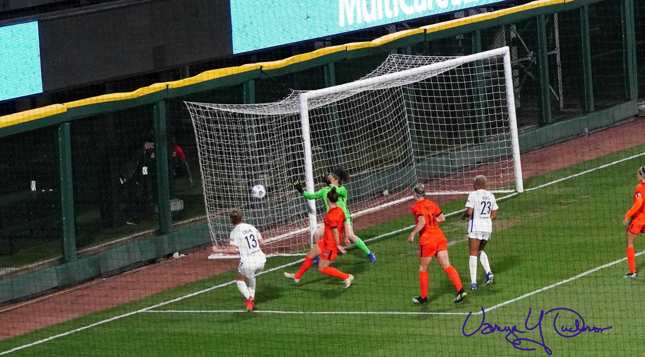 Celia's effort finds the side netting