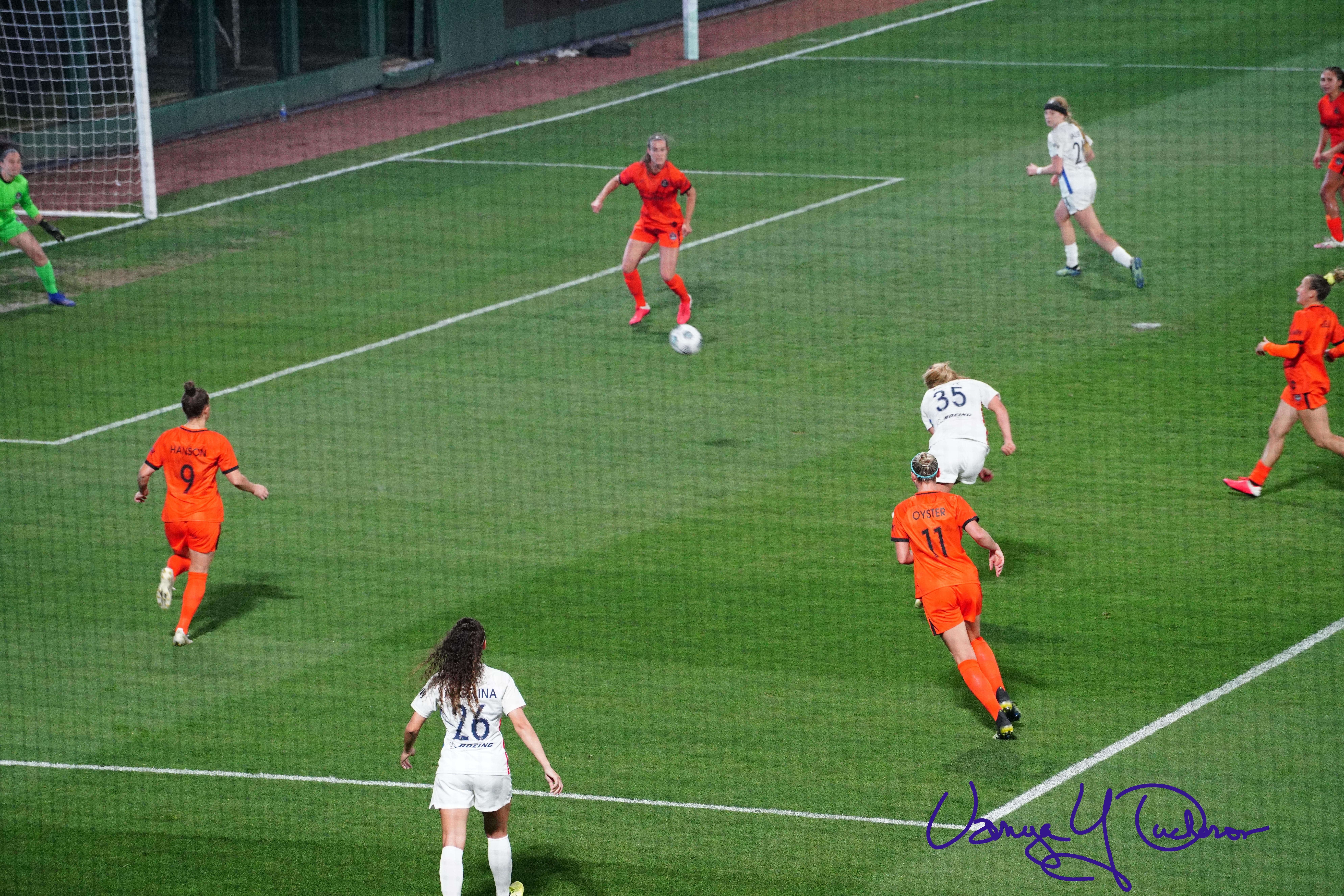 Leah Pruitt takes a drive at goal